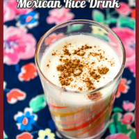 A glass of Horchata Rice Milk with cinnamon on top