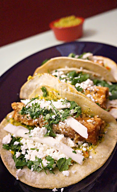 Pickled Jicama on fish tacos with pan roasted corn salsa