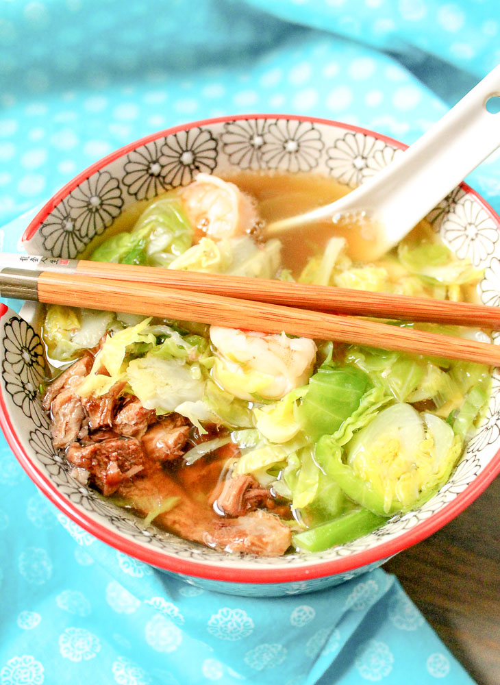 bowl of Asian soup with chopsticks