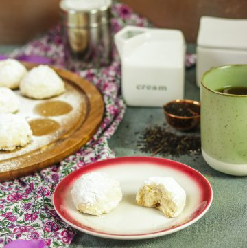 plate of Mexican Wedding Cookies with tea accoutrements