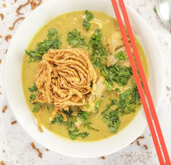 bowl of soup with noodles and chopstics