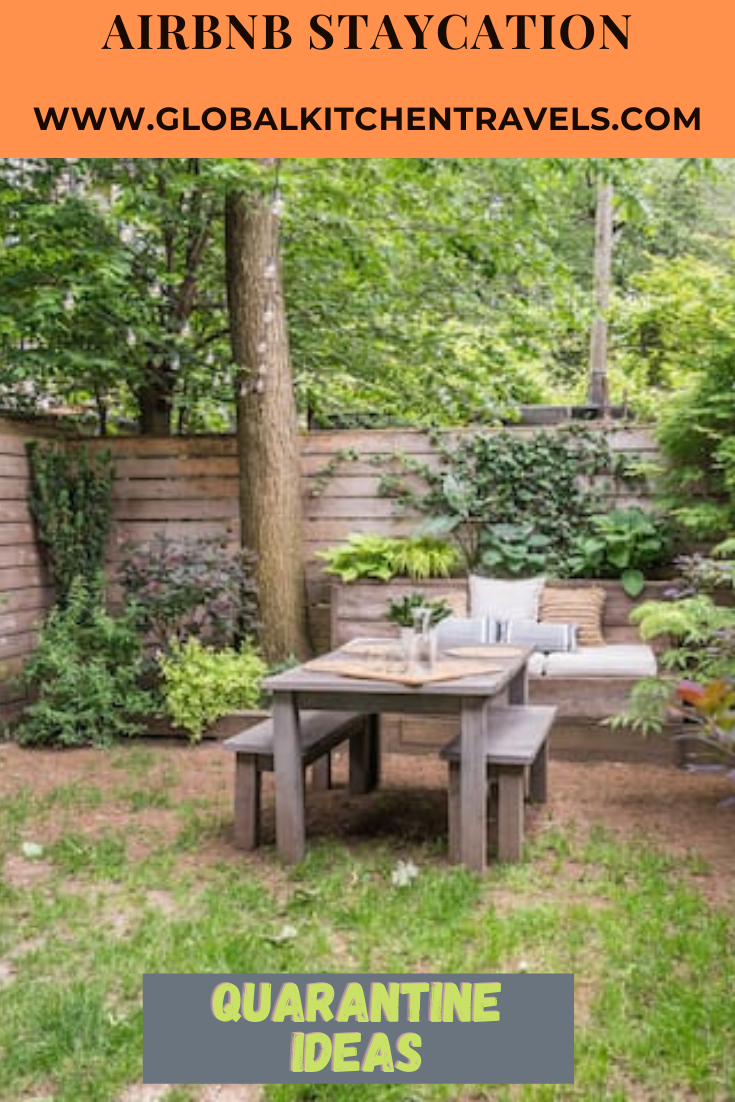 garden with table and bench and text