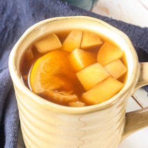 mug of ponche with fruit