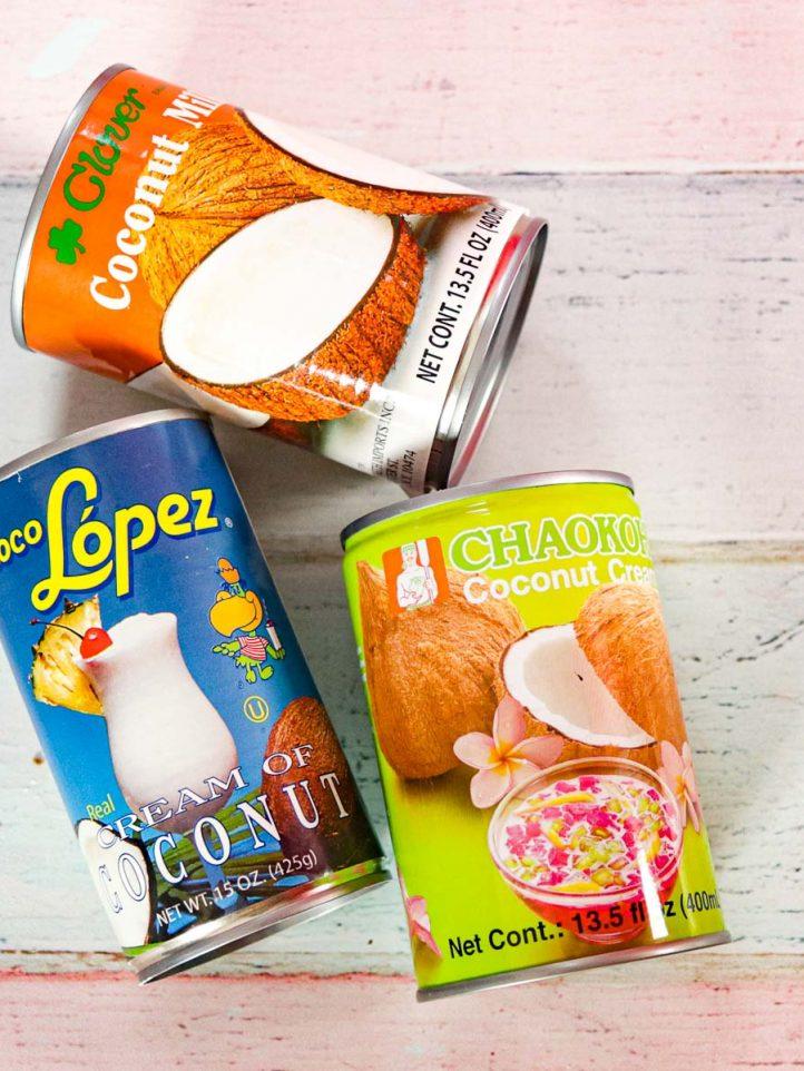 cans of coconut milk, coconut cream and cream of coconut