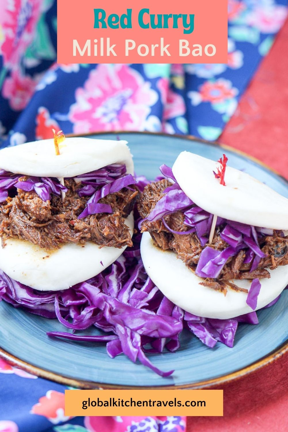 2 milk pork bao sandiwches on a plate with red cabbage