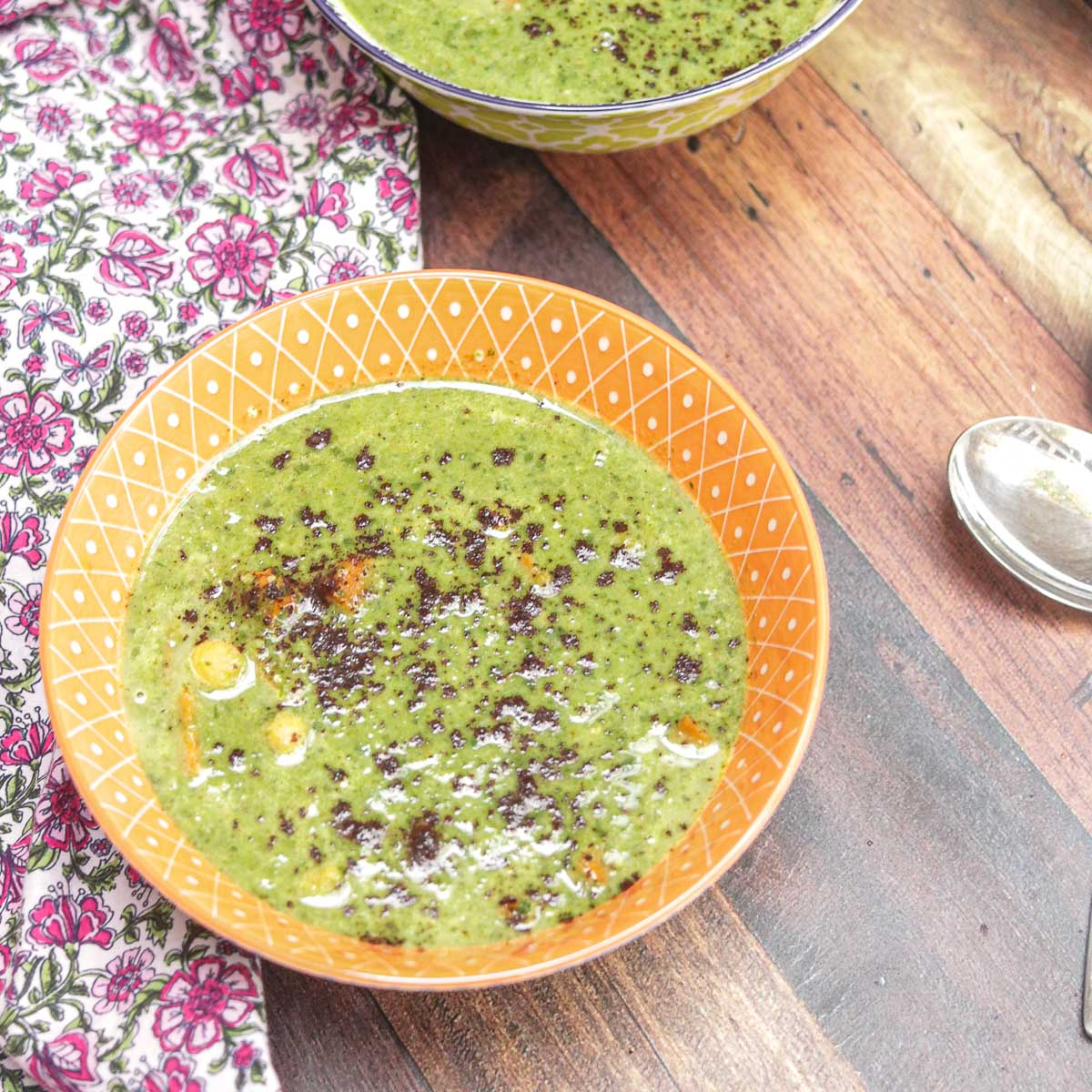 bowl of spinach soup with spoon