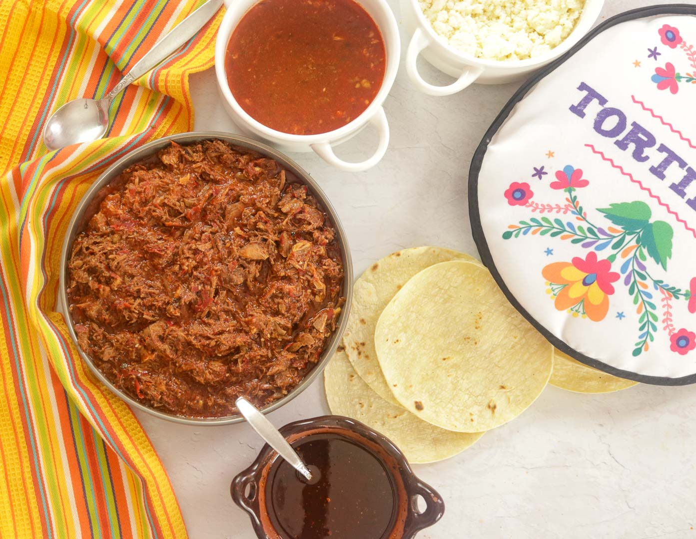 Goat Birria - consome - tortillas and salsa.