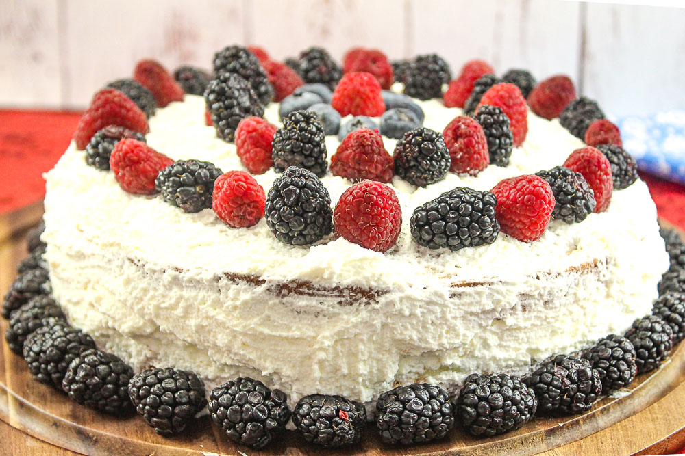 Cream Cake recipe with fresh berries and custard with whipped cream frosting