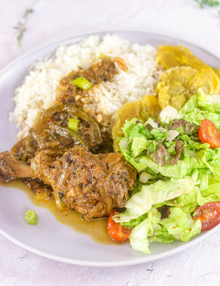 Haitian Chicken Stew Platter with Poulet en Sauce, Salad, Banane Peze and Rice