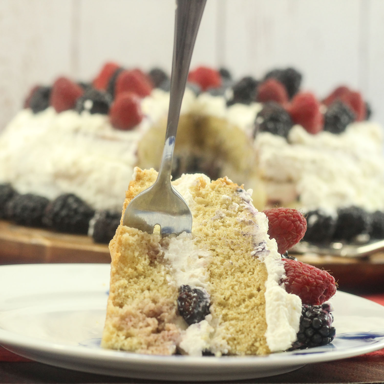 Layered Cream Cake with Fresh Berries.