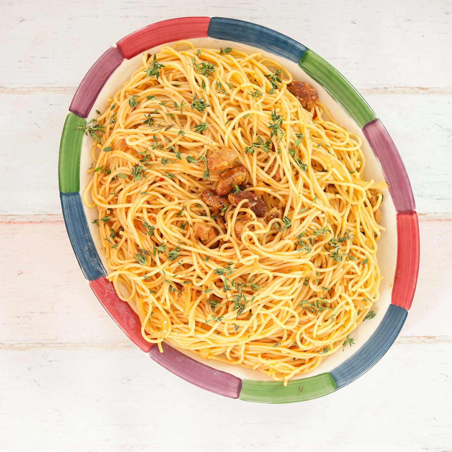 plate of spaghetti with sausage
