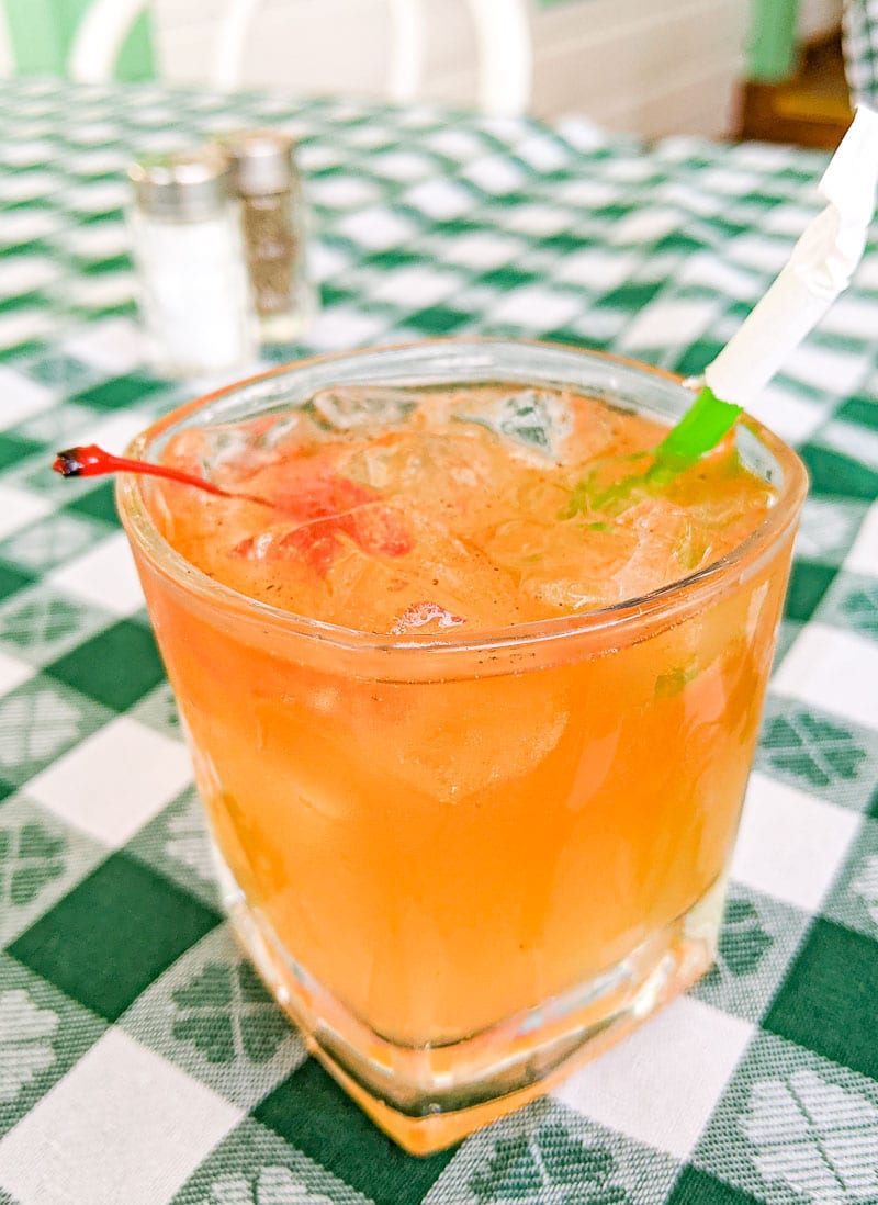Old Fashioned Rum Punch in a glass on table at Hemingway's Restaurant Antigua