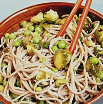 Soba Noodle Salad with Brussel Sprouts in a bowl with chopsticks