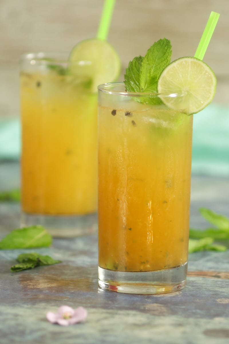 Mojito cocktail in glasses with lime and mint