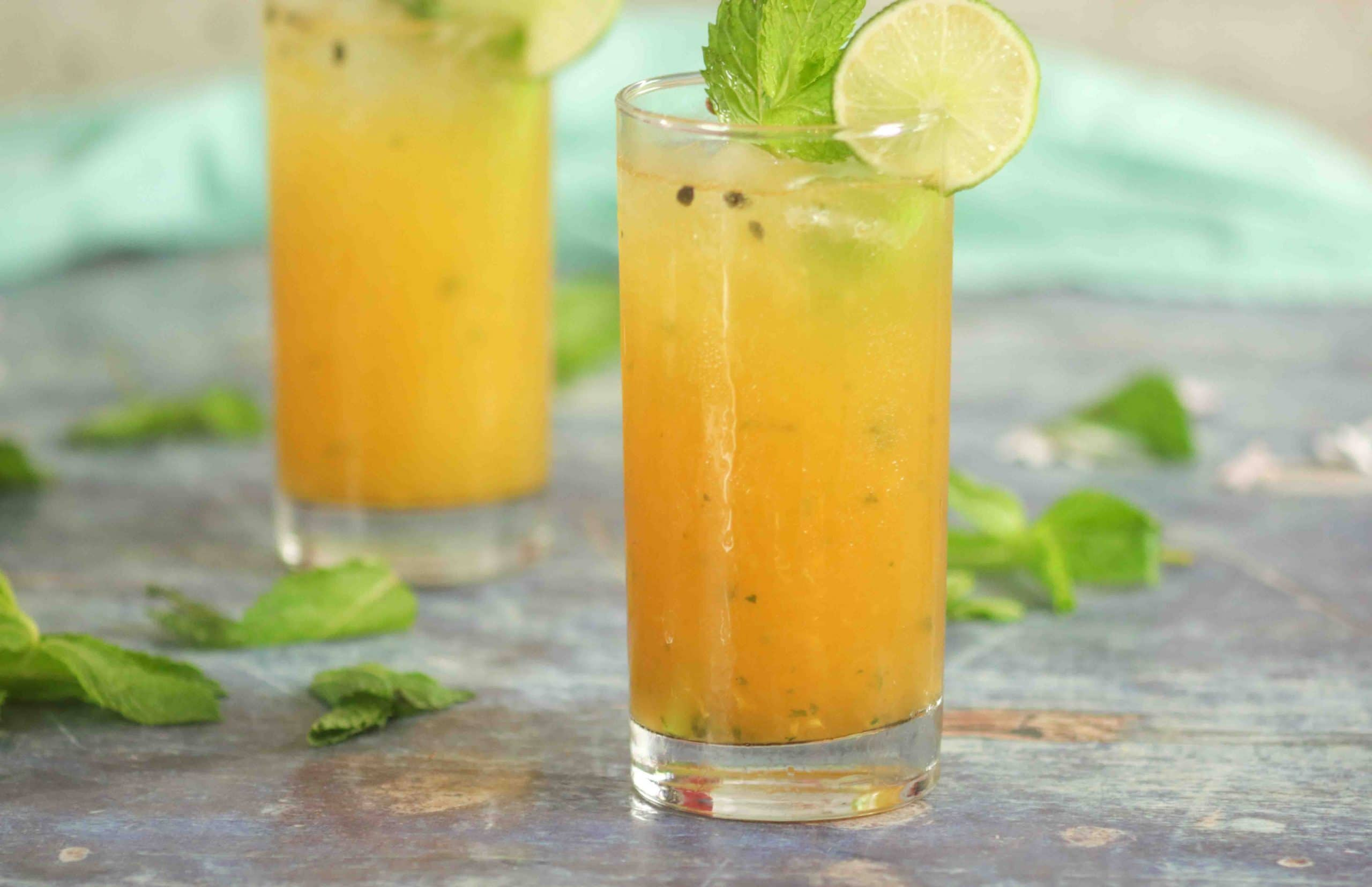 glasses of mojito with fresh mint and lime
