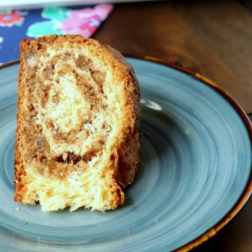 slice of Gubana Recipe - Italian Sweet Bread on a blue plate on a wooden table