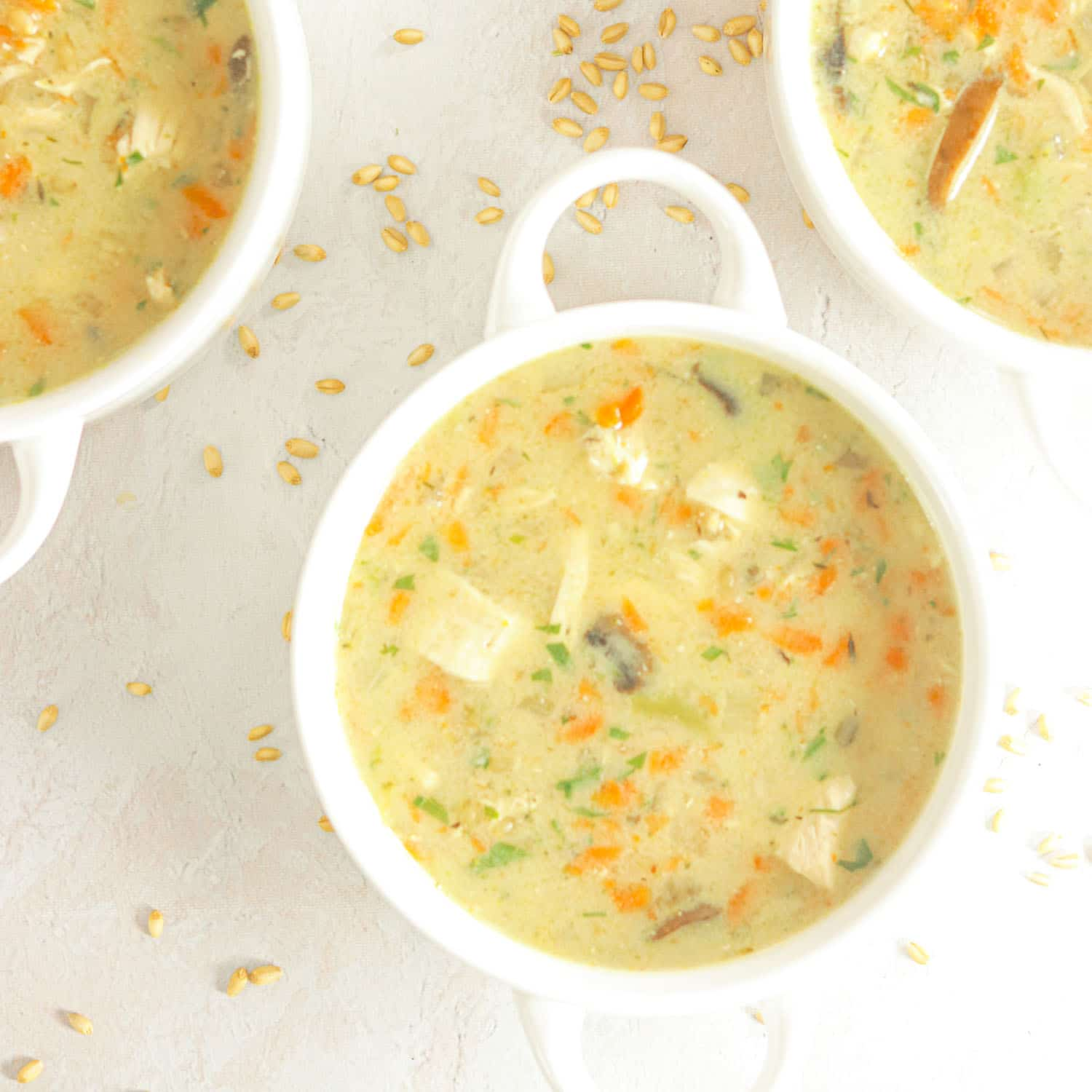 Chicken Soup in bowls with vegetables and wheat berries