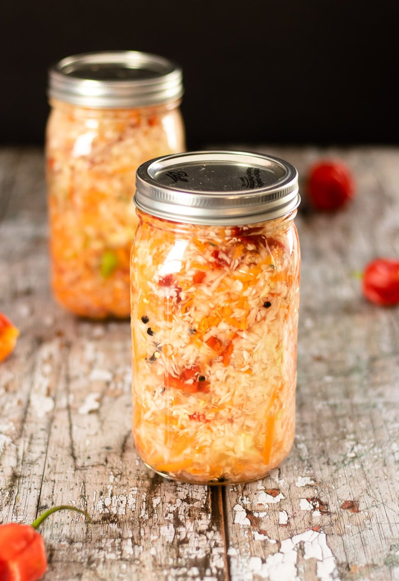 Haitian Pikliz in jars with Scotch Bonnet peppers