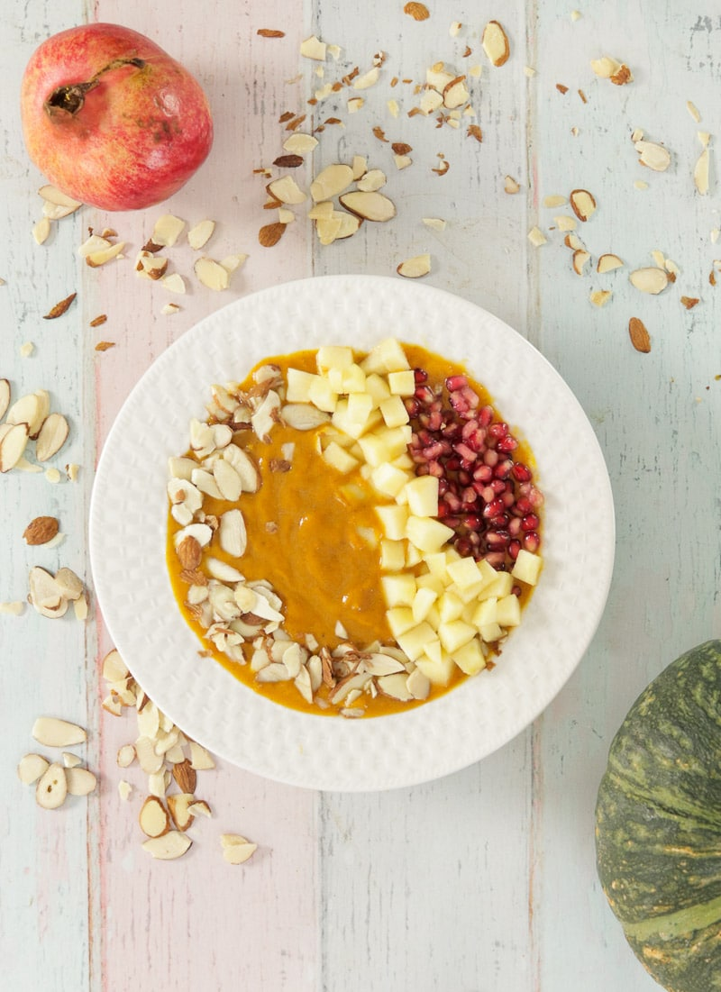 Pumpkin Smoothie Bowl with almonds, apples and pomegranate